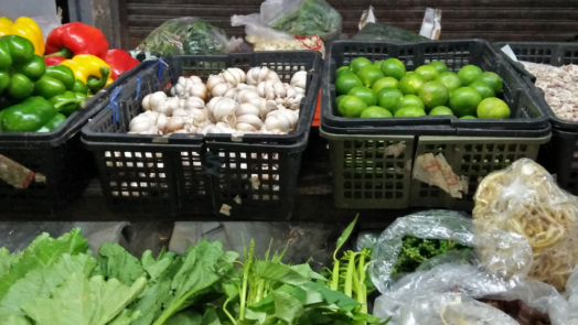 bang-rak-market-produce-vender-selling-fresh-produce