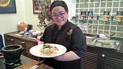 Blue-Elephant-cooking-school-teacher-holding-dish