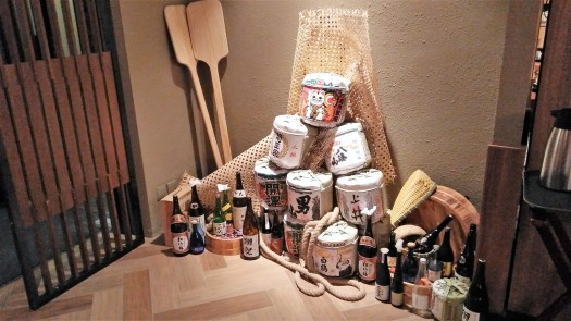 image-of-sake-bottles-and-barrels-at-japanese-restaurant-in-hong-kong