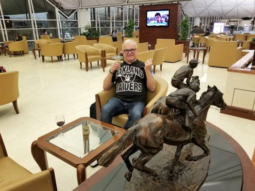 image-of-emirates-airline-hong-kong-airport-business-class-lounge-passenger-relaxing-with-champagne