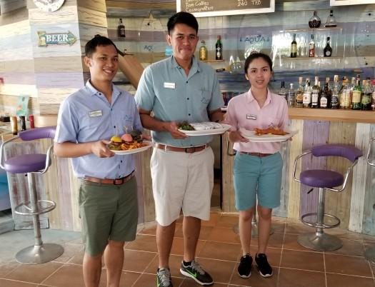 image-of-mercure-hotel-pattaya-aqua-pool-bar-and-club-servers-with-food